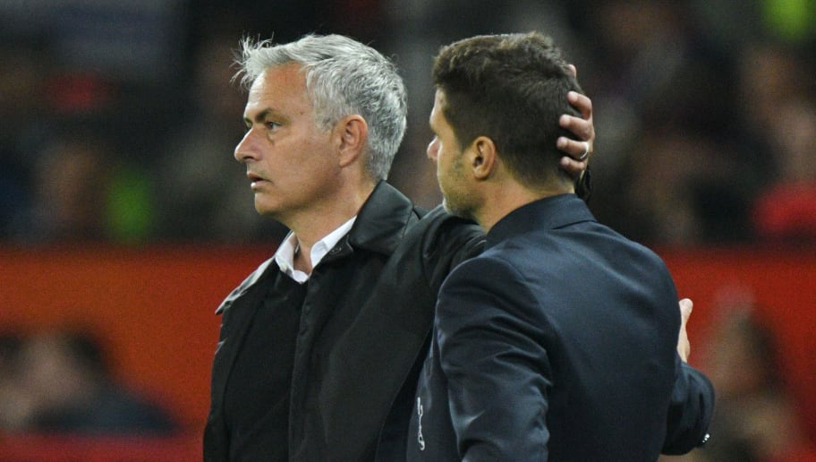 Manchester United's Portuguese manager Jose Mourinho (L) shakes hands with Tottenham Hotspur's Argentinian head coach Mauricio Pochettino (R) on the touchline towards the end of the English Premier League football match between Manchester United and Tottenham Hotspur at Old Trafford in Manchester, north west England, on August 27, 2018. (Photo by Oli SCARFF / AFP) / RESTRICTED TO EDITORIAL USE. No use with unauthorized audio, video, data, fixture lists, club/league logos or 'live' services. Online in-match use limited to 120 images. An additional 40 images may be used in extra time. No video emulation. Social media in-match use limited to 120 images. An additional 40 images may be used in extra time. No use in betting publications, games or single club/league/player publications. /         (Photo credit should read OLI SCARFF/AFP/Getty Images)