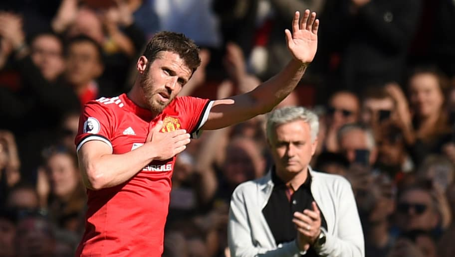 Manchester United's English midfielder Michael Carrick waves to the crowd as he leaves the pitch after being substituted during the English Premier League football match between Manchester United and Watford at Old Trafford in Manchester, north west England, on May 13, 2018. (Photo by Oli SCARFF / AFP) / RESTRICTED TO EDITORIAL USE. No use with unauthorized audio, video, data, fixture lists, club/league logos or 'live' services. Online in-match use limited to 75 images, no video emulation. No use in betting, games or single club/league/player publications. /         (Photo credit should read OLI SCARFF/AFP/Getty Images)