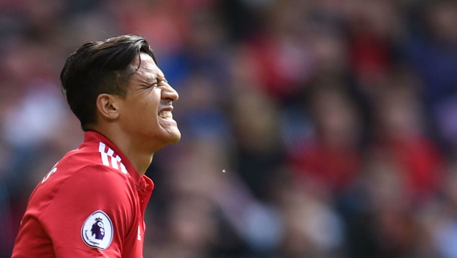 Manchester United's Chilean striker Alexis Sanchez reacts during the English Premier League football match between Manchester United and Watford at Old Trafford in Manchester, north west England, on May 13, 2018. (Photo by Oli SCARFF / AFP) / RESTRICTED TO EDITORIAL USE. No use with unauthorized audio, video, data, fixture lists, club/league logos or 'live' services. Online in-match use limited to 75 images, no video emulation. No use in betting, games or single club/league/player publications. /         (Photo credit should read OLI SCARFF/AFP/Getty Images)