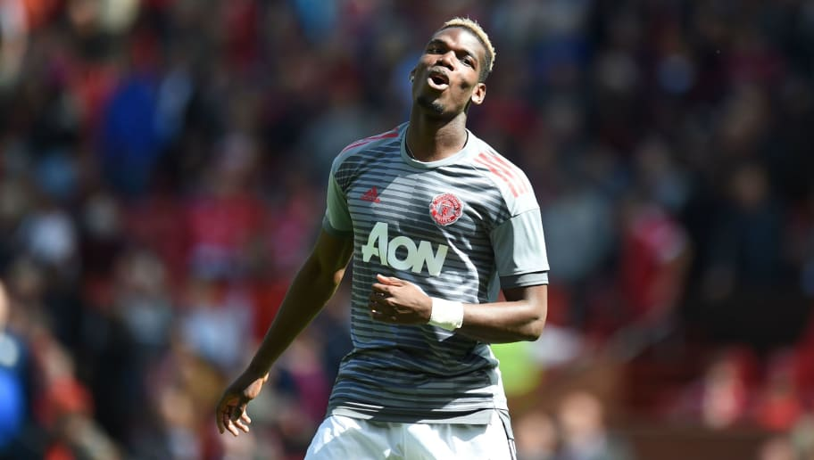 Manchester United's French midfielder Paul Pogba warms up for the English Premier League football match between Manchester United and Watford at Old Trafford in Manchester, north west England, on May 13, 2018. (Photo by Oli SCARFF / AFP) / RESTRICTED TO EDITORIAL USE. No use with unauthorized audio, video, data, fixture lists, club/league logos or 'live' services. Online in-match use limited to 75 images, no video emulation. No use in betting, games or single club/league/player publications. /         (Photo credit should read OLI SCARFF/AFP/Getty Images)