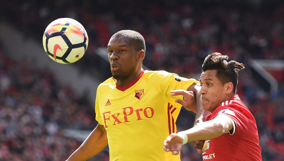 Manchester United's Chilean striker Alexis Sanchez (R) and Watford's Zaire-born Belgian defender Christian Kabasele (L) go for the ball during the English Premier League football match between Manchester United and Watford at Old Trafford in Manchester, north west England, on May 13, 2018. (Photo by Oli SCARFF / AFP) / RESTRICTED TO EDITORIAL USE. No use with unauthorized audio, video, data, fixture lists, club/league logos or 'live' services. Online in-match use limited to 75 images, no video emulation. No use in betting, games or single club/league/player publications. /         (Photo credit should read OLI SCARFF/AFP/Getty Images)