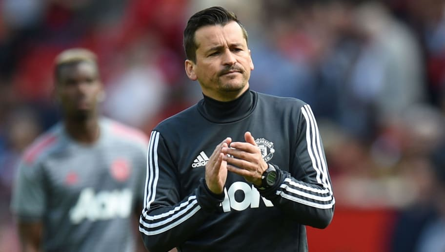 Manchester United's Portuguese assistant manager Rui Faria (C) walks among the players during the warm up ahead of the English Premier League football match between Manchester United and Watford at Old Trafford in Manchester, north west England, on May 13, 2018. (Photo by Oli SCARFF / AFP) / RESTRICTED TO EDITORIAL USE. No use with unauthorized audio, video, data, fixture lists, club/league logos or 'live' services. Online in-match use limited to 75 images, no video emulation. No use in betting, games or single club/league/player publications. /         (Photo credit should read OLI SCARFF/AFP/Getty Images)