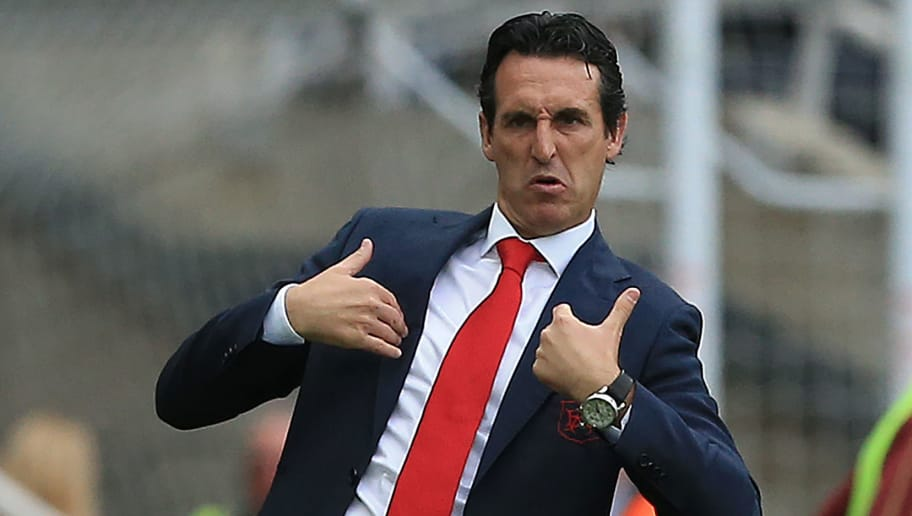 Arsenal's Spanish head coach Unai Emery reacts during the English Premier League football match between Newcastle United and Arsenal at St James' Park in Newcastle-upon-Tyne, north east England on September 15, 2018. (Photo by Lindsey PARNABY / AFP) / RESTRICTED TO EDITORIAL USE. No use with unauthorized audio, video, data, fixture lists, club/league logos or 'live' services. Online in-match use limited to 120 images. An additional 40 images may be used in extra time. No video emulation. Social media in-match use limited to 120 images. An additional 40 images may be used in extra time. No use in betting publications, games or single club/league/player publications. /         (Photo credit should read LINDSEY PARNABY/AFP/Getty Images)