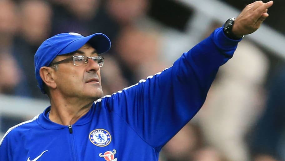 Chelsea's Italian head coach Maurizio Sarri gestures from the touchline during the English Premier League football match between Newcastle United and Chelsea at St James' Park in Newcastle-upon-Tyne, north east England on August 26, 2018. (Photo by Lindsey PARNABY / AFP) / RESTRICTED TO EDITORIAL USE. No use with unauthorized audio, video, data, fixture lists, club/league logos or 'live' services. Online in-match use limited to 120 images. An additional 40 images may be used in extra time. No video emulation. Social media in-match use limited to 120 images. An additional 40 images may be used in extra time. No use in betting publications, games or single club/league/player publications. /         (Photo credit should read LINDSEY PARNABY/AFP/Getty Images)