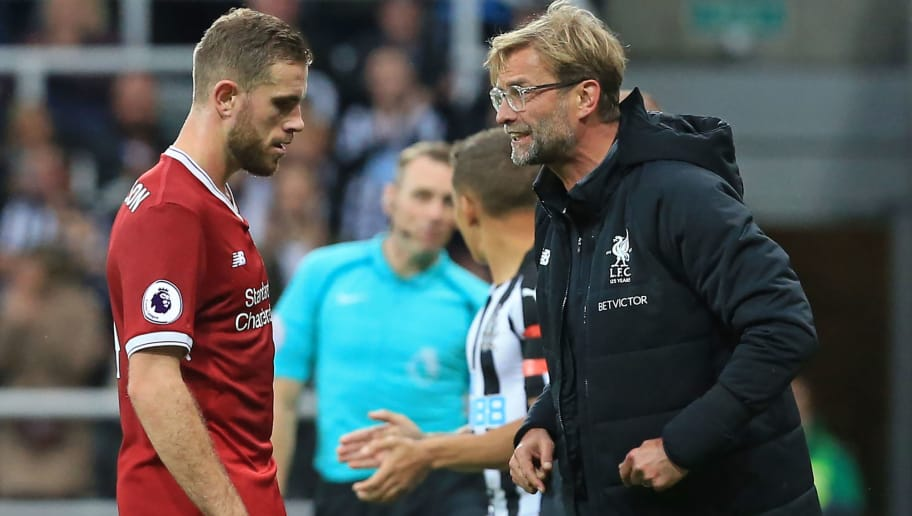 Liverpool's German manager Jurgen Klopp (R) speaks to Liverpool's English midfielder Jordan Henderson during the English Premier League football match between Newcastle United and Liverpool at St James' Park in Newcastle-upon-Tyne, north east England on October 1, 2017. The game ended 1-1. / AFP PHOTO / Lindsey PARNABY / RESTRICTED TO EDITORIAL USE. No use with unauthorized audio, video, data, fixture lists, club/league logos or 'live' services. Online in-match use limited to 75 images, no video emulation. No use in betting, games or single club/league/player publications.  /         (Photo credit should read LINDSEY PARNABY/AFP/Getty Images)