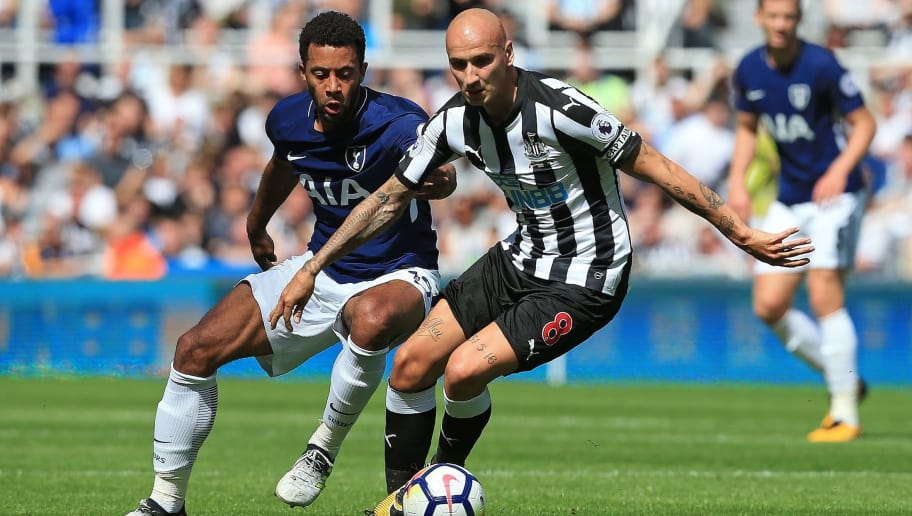 Tottenham Hotspur's Belgian midfielder Mousa Dembele (L) vies with Newcastle United's English midfielder Jonjo Shelvey during the English Premier League football match between Newcastle United and Totenham Hotspur at St James' Park in Newcastle-upon-Tyne, north east England on August 13, 2017. / AFP PHOTO / Lindsey PARNABY / RESTRICTED TO EDITORIAL USE. No use with unauthorized audio, video, data, fixture lists, club/league logos or 'live' services. Online in-match use limited to 75 images, no video emulation. No use in betting, games or single club/league/player publications.  /         (Photo credit should read LINDSEY PARNABY/AFP/Getty Images)