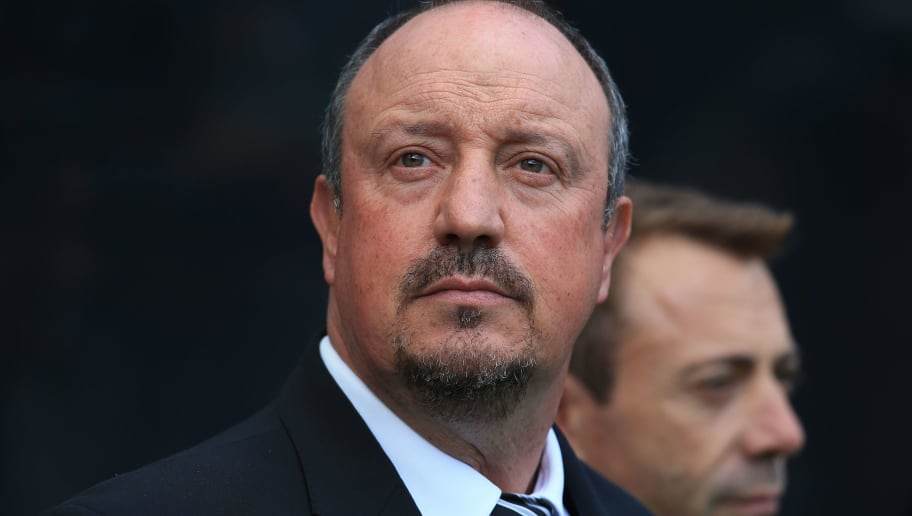 Newcastle United's Spanish manager Rafael Benitez reacts ahead of the English Premier League football match between Newcastle United and Tottenham Hotspur at St James' Park in Newcastle-upon-Tyne, north east England on August 11, 2018. - Tottenham won the match 2-1. (Photo by Lindsey PARNABY / AFP) / RESTRICTED TO EDITORIAL USE. No use with unauthorized audio, video, data, fixture lists, club/league logos or 'live' services. Online in-match use limited to 120 images. An additional 40 images may be used in extra time. No video emulation. Social media in-match use limited to 120 images. An additional 40 images may be used in extra time. No use in betting publications, games or single club/league/player publications. /         (Photo credit should read LINDSEY PARNABY/AFP/Getty Images)