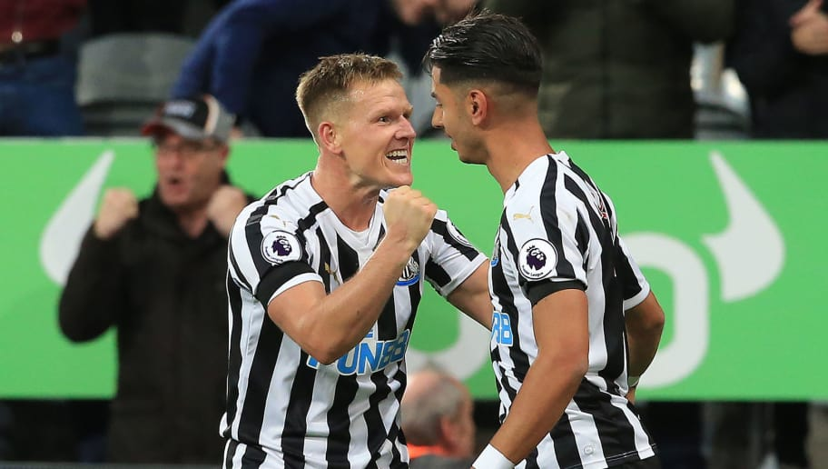 Newcastle United's Spanish striker Ayoze Perez (R) celebrates scoring the opening goal during the English Premier League football match between Newcastle United and Watford at St James' Park in Newcastle-upon-Tyne, north east England on November 3, 2018. (Photo by Lindsey PARNABY / AFP) / RESTRICTED TO EDITORIAL USE. No use with unauthorized audio, video, data, fixture lists, club/league logos or 'live' services. Online in-match use limited to 120 images. An additional 40 images may be used in extra time. No video emulation. Social media in-match use limited to 120 images. An additional 40 images may be used in extra time. No use in betting publications, games or single club/league/player publications. /         (Photo credit should read LINDSEY PARNABY/AFP/Getty Images)