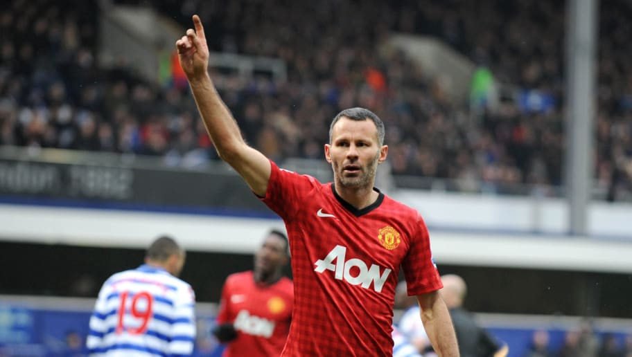 "Manchester United's Welsh midfielder Ryan Giggs celebrates scoring their second goal during the English Premier League football match between Queens Park Rangers and Manchester United at Loftus Road in London on February 23, 2013. Manchester United won the game 2-0. AFP PHOTO/OLLY GREENWOOD  RESTRICTED TO EDITORIAL USE. No use with unauthorized audio, video, data, fixture lists, club/league logos or ""live"" services. Online in-match use limited to 45 images, no video emulation. No use in betting, games or single club/league/player publications        (Photo credit should read OLLY GREENWOOD/AFP/Getty Images)"