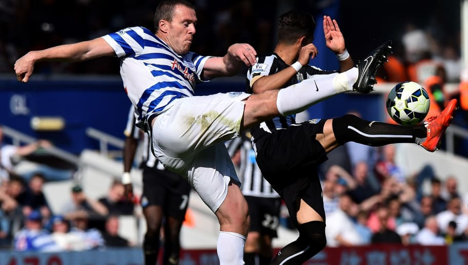 Queens Park Rangers' Irish defender Richard Dunne clears the ball during the English Premier League football match between Queens Park Rangers and Newcastle United at Loftus Road in London on May 16, 2015. AFP PHOTO / BEN STANSALL  RESTRICTED TO EDITORIAL USE. No use with unauthorized audio, video, data, fixture lists, club/league logos or live services. Online in-match use limited to 45 images, no video emulation. No use in betting, games or single club/league/player publications        (Photo credit should read BEN STANSALL/AFP/Getty Images)