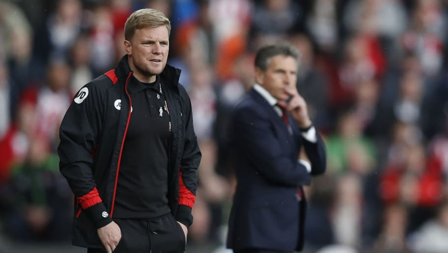 Bournemouth's English manager Eddie Howe (L) and Southampton's French manager Claude Puel watch from the touchline during the English Premier League football match between Southampton and Bournemouth at St Mary's Stadium in Southampton, southern England on April 1, 2017. / AFP PHOTO / Adrian DENNIS / RESTRICTED TO EDITORIAL USE. No use with unauthorized audio, video, data, fixture lists, club/league logos or 'live' services. Online in-match use limited to 75 images, no video emulation. No use in betting, games or single club/league/player publications.  /         (Photo credit should read ADRIAN DENNIS/AFP/Getty Images)