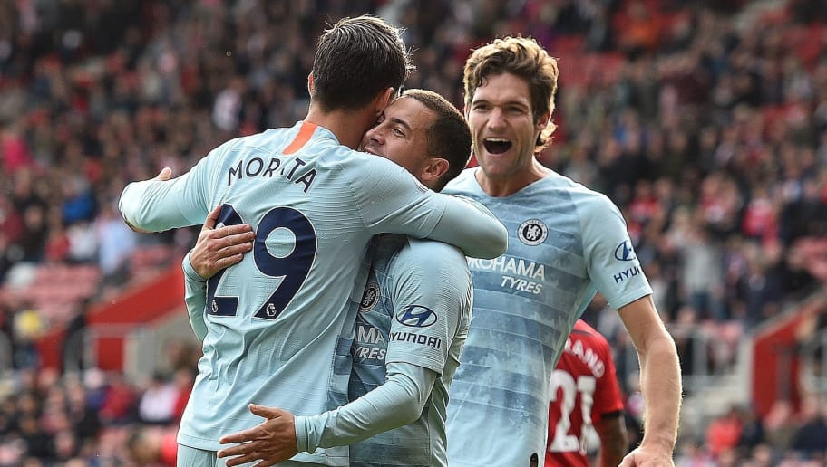 Chelsea's Spanish striker Alvaro Morata (L) celebrates scoring his team's third goal with Chelsea's Belgian midfielder Eden Hazard (C) and Chelsea's Spanish defender Marcos Alonso during the English Premier League football match between Southampton and Chelsea at St Mary's Stadium in Southampton, southern England on October 7, 2018. (Photo by Glyn KIRK / AFP) / RESTRICTED TO EDITORIAL USE. No use with unauthorized audio, video, data, fixture lists, club/league logos or 'live' services. Online in-match use limited to 120 images. An additional 40 images may be used in extra time. No video emulation. Social media in-match use limited to 120 images. An additional 40 images may be used in extra time. No use in betting publications, games or single club/league/player publications. /         (Photo credit should read GLYN KIRK/AFP/Getty Images)