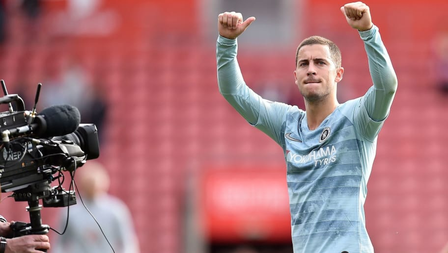 A television broadcast camera films as Chelsea's Belgian midfielder Eden Hazard applauds the fans following the English Premier League football match between Southampton and Chelsea at St Mary's Stadium in Southampton, southern England on October 7, 2018. - Chelsea won the match 3-0. (Photo by Glyn KIRK / AFP) / RESTRICTED TO EDITORIAL USE. No use with unauthorized audio, video, data, fixture lists, club/league logos or 'live' services. Online in-match use limited to 120 images. An additional 40 images may be used in extra time. No video emulation. Social media in-match use limited to 120 images. An additional 40 images may be used in extra time. No use in betting publications, games or single club/league/player publications. /         (Photo credit should read GLYN KIRK/AFP/Getty Images)
