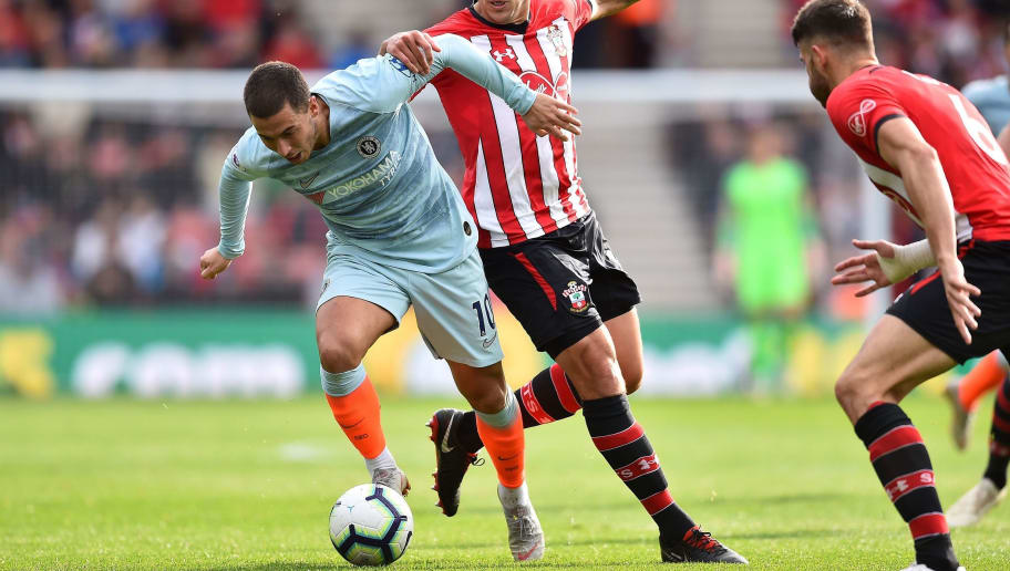 Southampton's Spanish midfielder Oriol Romeu vies with Chelsea's Belgian midfielder Eden Hazard during the English Premier League football match between Southampton and Chelsea at St Mary's Stadium in Southampton, southern England on October 7, 2018. (Photo by Glyn KIRK / AFP) / RESTRICTED TO EDITORIAL USE. No use with unauthorized audio, video, data, fixture lists, club/league logos or 'live' services. Online in-match use limited to 120 images. An additional 40 images may be used in extra time. No video emulation. Social media in-match use limited to 120 images. An additional 40 images may be used in extra time. No use in betting publications, games or single club/league/player publications. /         (Photo credit should read GLYN KIRK/AFP/Getty Images)