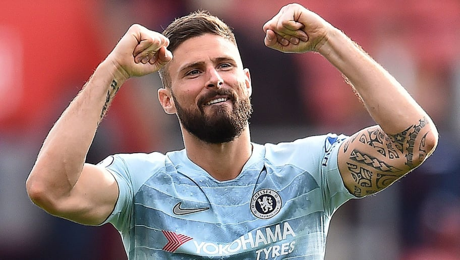 Chelsea's French striker Olivier Giroud applauds the fans following the English Premier League football match between Southampton and Chelsea at St Mary's Stadium in Southampton, southern England on October 7, 2018. - Chelsea won the match 3-0. (Photo by Glyn KIRK / AFP) / RESTRICTED TO EDITORIAL USE. No use with unauthorized audio, video, data, fixture lists, club/league logos or 'live' services. Online in-match use limited to 120 images. An additional 40 images may be used in extra time. No video emulation. Social media in-match use limited to 120 images. An additional 40 images may be used in extra time. No use in betting publications, games or single club/league/player publications. /         (Photo credit should read GLYN KIRK/AFP/Getty Images)