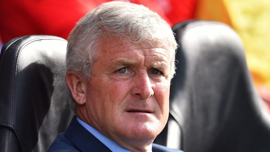 Southampton Welsh manager Mark Hughes reacts during the English Premier League football match between Southampton and Chelsea at St Mary's Stadium in Southampton, southern England on October 7, 2018. (Photo by Glyn KIRK / AFP) / RESTRICTED TO EDITORIAL USE. No use with unauthorized audio, video, data, fixture lists, club/league logos or 'live' services. Online in-match use limited to 120 images. An additional 40 images may be used in extra time. No video emulation. Social media in-match use limited to 120 images. An additional 40 images may be used in extra time. No use in betting publications, games or single club/league/player publications. /         (Photo credit should read GLYN KIRK/AFP/Getty Images)