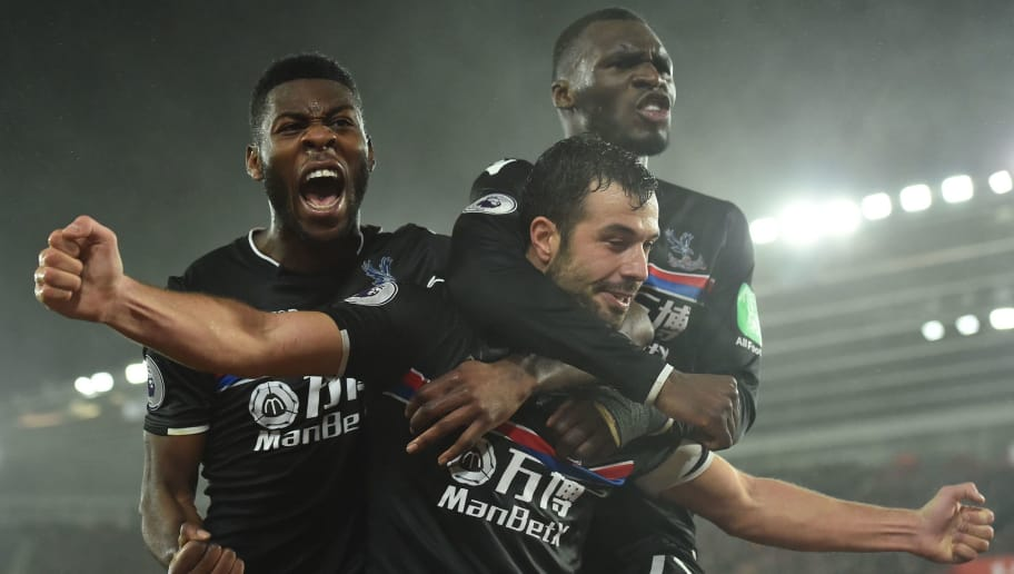 Crystal Palace's Serbian midfielder Luka Milivojevic celebrates with Crystal Palace's Dutch defender Timothy Fosu-Mensah (L) and Crystal Palace's Zaire-born Belgian striker Christian Benteke (R) after scoring their second goal during the English Premier League football match between Southampton and Crystal Palace at St Mary's Stadium in Southampton, southern England on January 2, 2018. / AFP PHOTO / Glyn KIRK / RESTRICTED TO EDITORIAL USE. No use with unauthorized audio, video, data, fixture lists, club/league logos or 'live' services. Online in-match use limited to 75 images, no video emulation. No use in betting, games or single club/league/player publications.  /         (Photo credit should read GLYN KIRK/AFP/Getty Images)