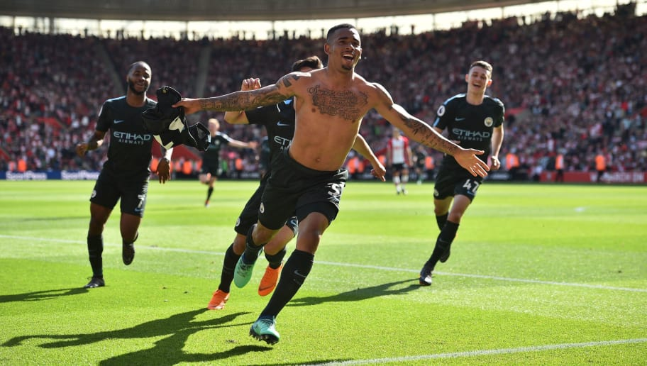Manchester City's Brazilian striker Gabriel Jesus celebrates scoring the opening goal during the English Premier League football match between Southampton and Manchester City at St Mary's Stadium in Southampton, southern England on May 13, 2018. (Photo by Glyn KIRK / AFP) / RESTRICTED TO EDITORIAL USE. No use with unauthorized audio, video, data, fixture lists, club/league logos or 'live' services. Online in-match use limited to 75 images, no video emulation. No use in betting, games or single club/league/player publications. /         (Photo credit should read GLYN KIRK/AFP/Getty Images)