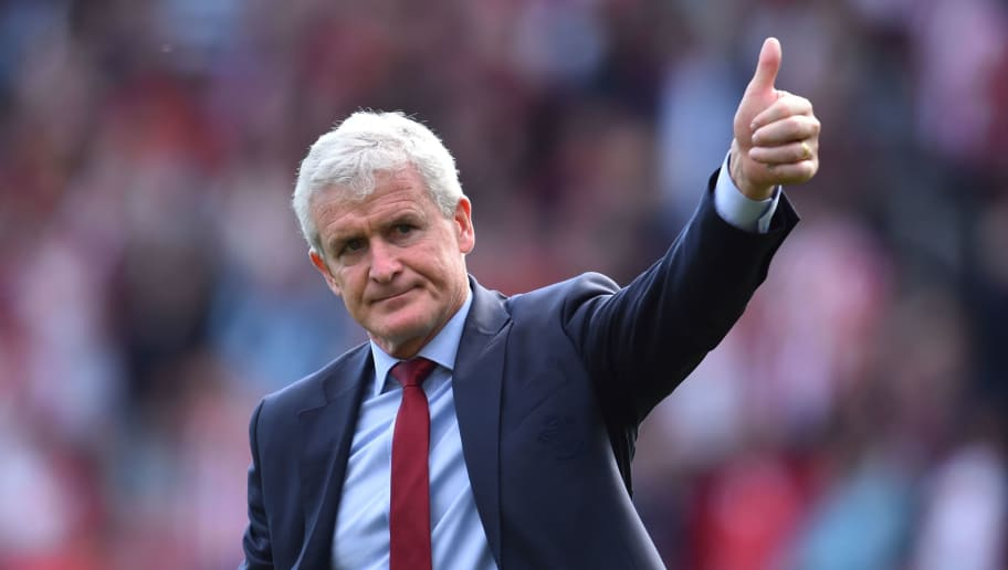 Southampton Welsh manager Mark Hughes gives a thumbs up to the fans at the end of the English Premier League football match between Southampton and Manchester City at St Mary's Stadium in Southampton, southern England on May 13, 2018. (Photo by Glyn KIRK / AFP) / RESTRICTED TO EDITORIAL USE. No use with unauthorized audio, video, data, fixture lists, club/league logos or 'live' services. Online in-match use limited to 75 images, no video emulation. No use in betting, games or single club/league/player publications. /         (Photo credit should read GLYN KIRK/AFP/Getty Images)