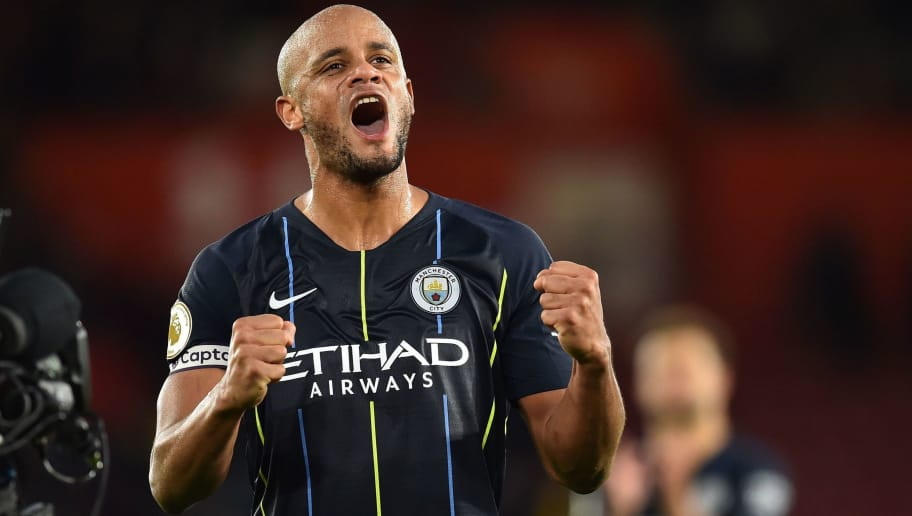 Manchester City's Belgian defender Vincent Kompany celebrates on the pitch after the English Premier League football match between Southampton and Manchester City at St Mary's Stadium in Southampton, southern England on December 30, 2018. - Manchester City won the game 3-1. (Photo by Glyn KIRK / AFP) / RESTRICTED TO EDITORIAL USE. No use with unauthorized audio, video, data, fixture lists, club/league logos or 'live' services. Online in-match use limited to 120 images. An additional 40 images may be used in extra time. No video emulation. Social media in-match use limited to 120 images. An additional 40 images may be used in extra time. No use in betting publications, games or single club/league/player publications. /         (Photo credit should read GLYN KIRK/AFP/Getty Images)