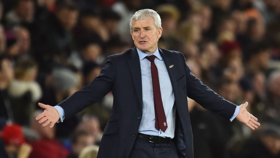 Southampton Welsh manager Mark Hughes reacts on the touchline during the English Premier League football match between Southampton and Manchester United at St Mary's Stadium in Southampton, southern England on December 1, 2018. (Photo by Glyn KIRK / AFP) / RESTRICTED TO EDITORIAL USE. No use with unauthorized audio, video, data, fixture lists, club/league logos or 'live' services. Online in-match use limited to 120 images. An additional 40 images may be used in extra time. No video emulation. Social media in-match use limited to 120 images. An additional 40 images may be used in extra time. No use in betting publications, games or single club/league/player publications. /         (Photo credit should read GLYN KIRK/AFP/Getty Images)