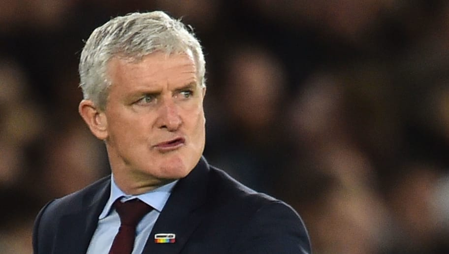 Southampton Welsh manager Mark Hughes reacts during the English Premier League football match between Southampton and Manchester United at St Mary's Stadium in Southampton, southern England on December 1, 2018. (Photo by Glyn KIRK / AFP) / RESTRICTED TO EDITORIAL USE. No use with unauthorized audio, video, data, fixture lists, club/league logos or 'live' services. Online in-match use limited to 120 images. An additional 40 images may be used in extra time. No video emulation. Social media in-match use limited to 120 images. An additional 40 images may be used in extra time. No use in betting publications, games or single club/league/player publications. /         (Photo credit should read GLYN KIRK/AFP/Getty Images)