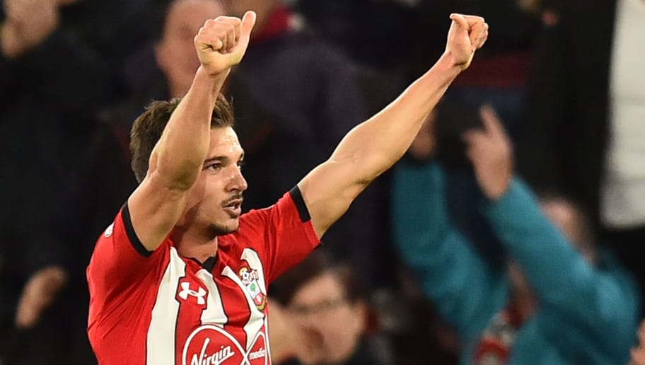 Southampton's German-born Portuguese defender Cedric Soares celebrates scoring their second goal for 2-0 during the English Premier League football match between Southampton and Manchester United at St Mary's Stadium in Southampton, southern England on December 1, 2018. (Photo by Glyn KIRK / AFP) / RESTRICTED TO EDITORIAL USE. No use with unauthorized audio, video, data, fixture lists, club/league logos or 'live' services. Online in-match use limited to 120 images. An additional 40 images may be used in extra time. No video emulation. Social media in-match use limited to 120 images. An additional 40 images may be used in extra time. No use in betting publications, games or single club/league/player publications. /         (Photo credit should read GLYN KIRK/AFP/Getty Images)