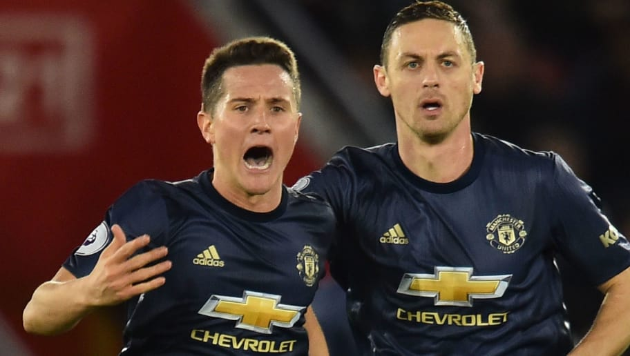 Manchester United's Spanish midfielder Ander Herrera (L) celebrates scoring their second goal to equalise 2-2 with Manchester United's Serbian midfielder Nemanja Matic (R) during the English Premier League football match between Southampton and Manchester United at St Mary's Stadium in Southampton, southern England on December 1, 2018. (Photo by Glyn KIRK / AFP) / RESTRICTED TO EDITORIAL USE. No use with unauthorized audio, video, data, fixture lists, club/league logos or 'live' services. Online in-match use limited to 120 images. An additional 40 images may be used in extra time. No video emulation. Social media in-match use limited to 120 images. An additional 40 images may be used in extra time. No use in betting publications, games or single club/league/player publications. /         (Photo credit should read GLYN KIRK/AFP/Getty Images)
