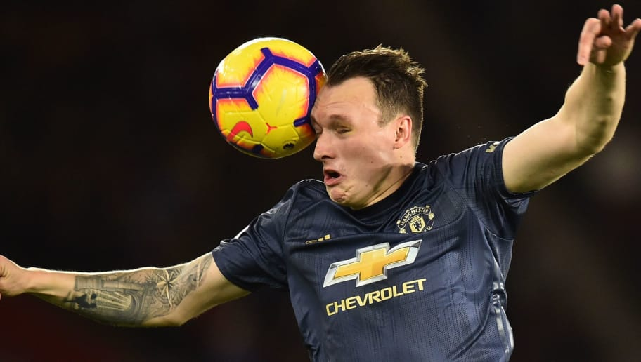 Manchester United's English defender Phil Jones heads the ball during the English Premier League football match between Southampton and Manchester United at St Mary's Stadium in Southampton, southern England on December 1, 2018. (Photo by Glyn KIRK / AFP) / RESTRICTED TO EDITORIAL USE. No use with unauthorized audio, video, data, fixture lists, club/league logos or 'live' services. Online in-match use limited to 120 images. An additional 40 images may be used in extra time. No video emulation. Social media in-match use limited to 120 images. An additional 40 images may be used in extra time. No use in betting publications, games or single club/league/player publications. /         (Photo credit should read GLYN KIRK/AFP/Getty Images)