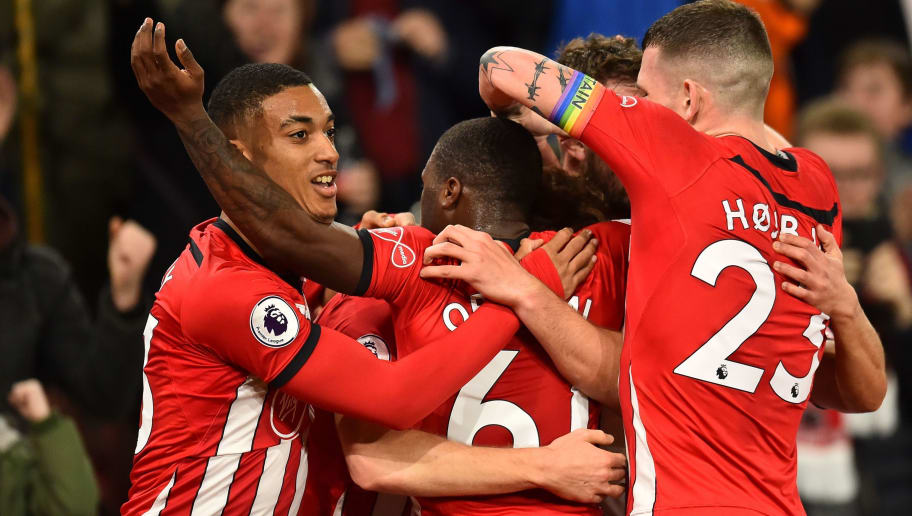 Southampton players celebrate their first goal scored by Southampton's Scottish midfielder Stuart Armstrong during the English Premier League football match between Southampton and Manchester United at St Mary's Stadium in Southampton, southern England on December 1, 2018. (Photo by Glyn KIRK / AFP) / RESTRICTED TO EDITORIAL USE. No use with unauthorized audio, video, data, fixture lists, club/league logos or 'live' services. Online in-match use limited to 120 images. An additional 40 images may be used in extra time. No video emulation. Social media in-match use limited to 120 images. An additional 40 images may be used in extra time. No use in betting publications, games or single club/league/player publications. /         (Photo credit should read GLYN KIRK/AFP/Getty Images)