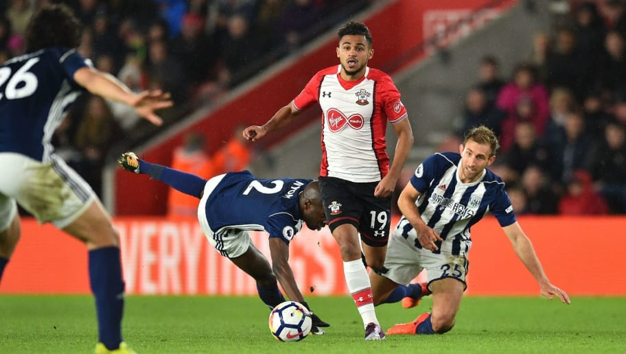 Southampton's Moroccan midfielder Sofiane Boufal (2nd R) runs past West Bromwich Albion's French-born Cameroonian defender Allan Nyom (2nd L) and West Bromwich Albion's English defender Craig Dawson (R) on his way to scoring the opening goal of the English Premier League football match between Southampton and West Bromwich Albion at St Mary's Stadium in Southampton, southern England on October 21, 2017. / AFP PHOTO / Glyn KIRK / RESTRICTED TO EDITORIAL USE. No use with unauthorized audio, video, data, fixture lists, club/league logos or 'live' services. Online in-match use limited to 75 images, no video emulation. No use in betting, games or single club/league/player publications.  /         (Photo credit should read GLYN KIRK/AFP/Getty Images)