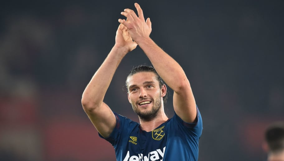 West Ham United's English striker Andy Carroll applauds supporters on the pitch after the English Premier League football match between Southampton and West Ham United at St Mary's Stadium in Southampton, southern England on December 27, 2018. - West Ham won the game 2-1. (Photo by Glyn KIRK / AFP) / RESTRICTED TO EDITORIAL USE. No use with unauthorized audio, video, data, fixture lists, club/league logos or 'live' services. Online in-match use limited to 120 images. An additional 40 images may be used in extra time. No video emulation. Social media in-match use limited to 120 images. An additional 40 images may be used in extra time. No use in betting publications, games or single club/league/player publications. /         (Photo credit should read GLYN KIRK/AFP/Getty Images)