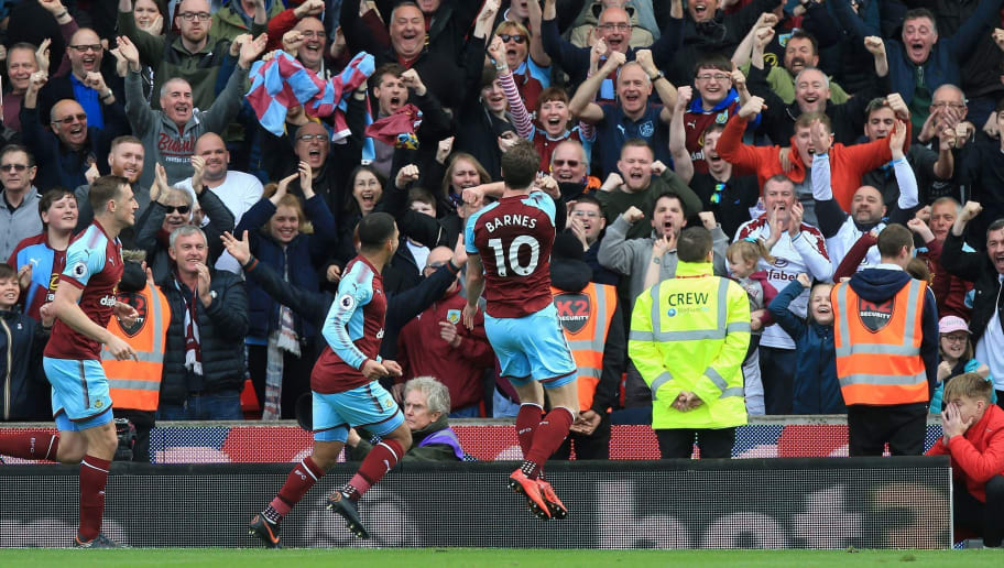 Burnley's English striker Ashley Barnes (C) celebrates scoring his team's first goal during the English Premier League football match between Stoke City and Burnley at the Bet365 Stadium in Stoke-on-Trent, central England on April 22, 2018. (Photo by Lindsey PARNABY / AFP) / RESTRICTED TO EDITORIAL USE. No use with unauthorized audio, video, data, fixture lists, club/league logos or 'live' services. Online in-match use limited to 75 images, no video emulation. No use in betting, games or single club/league/player publications. /         (Photo credit should read LINDSEY PARNABY/AFP/Getty Images)