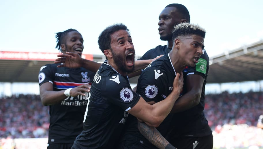 Crystal Palace's Dutch defender Patrick van Aanholt (R) celebrates scoring his team's second goal with Crystal Palace's Ivorian striker Wilfried Zaha (L) Crystal Palace's English midfielder Andros Townsend (2L) and Crystal Palace's Zaire-born Belgian striker Christian Benteke during the English Premier League football match between Stoke City and Crystal Palace at the Bet365 Stadium in Stoke-on-Trent, central England on May 5, 2018. (Photo by Oli SCARFF / AFP) / RESTRICTED TO EDITORIAL USE. No use with unauthorized audio, video, data, fixture lists, club/league logos or 'live' services. Online in-match use limited to 75 images, no video emulation. No use in betting, games or single club/league/player publications. /         (Photo credit should read OLI SCARFF/AFP/Getty Images)