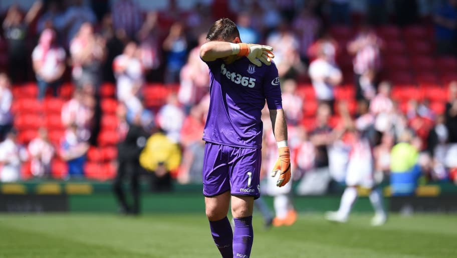 Stoke City's English goalkeeper Jack Butland leaves the pitch  following the English Premier League football match between Stoke City and Crystal Palace at the Bet365 Stadium in Stoke-on-Trent, central England on May 5, 2018. - Crystal Palace won the match 2-1. (Photo by Oli SCARFF / AFP) / RESTRICTED TO EDITORIAL USE. No use with unauthorized audio, video, data, fixture lists, club/league logos or 'live' services. Online in-match use limited to 75 images, no video emulation. No use in betting, games or single club/league/player publications. /         (Photo credit should read OLI SCARFF/AFP/Getty Images)