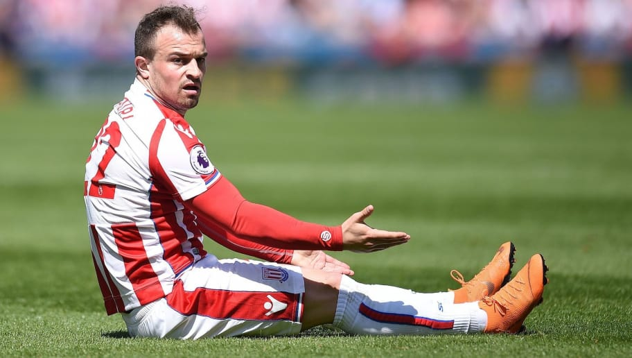 Stoke City's Swiss forward Xherdan Shaqiri reacts after being fouled, and winning a free-kick, during the English Premier League football match between Stoke City and Crystal Palace at the Bet365 Stadium in Stoke-on-Trent, central England on May 5, 2018. (Photo by Oli SCARFF / AFP) / RESTRICTED TO EDITORIAL USE. No use with unauthorized audio, video, data, fixture lists, club/league logos or 'live' services. Online in-match use limited to 75 images, no video emulation. No use in betting, games or single club/league/player publications. /         (Photo credit should read OLI SCARFF/AFP/Getty Images)