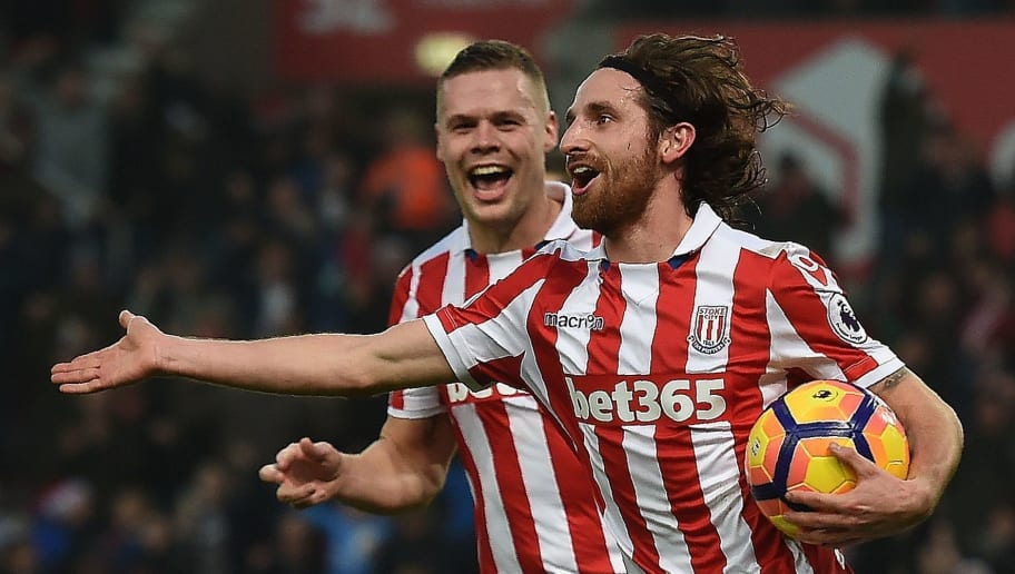Stoke City's Welsh midfielder Joe Allen (R) celebrates scoring his team's second goal during the English Premier League football match between Stoke City and Leicester City at the Bet365 Stadium in Stoke-on-Trent, central England on December 17, 2016. / AFP / Paul ELLIS / RESTRICTED TO EDITORIAL USE. No use with unauthorized audio, video, data, fixture lists, club/league logos or 'live' services. Online in-match use limited to 75 images, no video emulation. No use in betting, games or single club/league/player publications.  /         (Photo credit should read PAUL ELLIS/AFP/Getty Images)