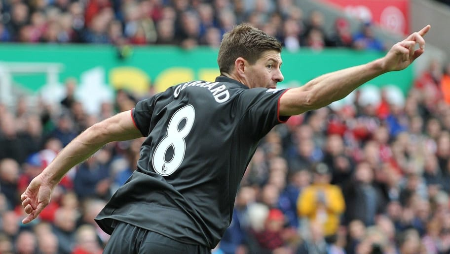 Liverpool's English midfielder Steven Gerrard celebrates scoring their first goal during the English Premier League football match between Stoke City and Liverpool at the Britannia Stadium in Stoke-on-Trent, central England on May 24, 2015. AFP PHOTO / STEVE PARKIN  RESTRICTED TO EDITORIAL USE. NO USE WITH UNAUTHORIZED AUDIO, VIDEO, DATA, FIXTURE LISTS, CLUB/LEAGUE LOGOS OR LIVE SERVICES. ONLINE IN-MATCH USE LIMITED TO 45 IMAGES, NO VIDEO EMULATION. NO USE IN BETTING, GAMES OR SINGLE CLUB/LEAGUE/PLAYER PUBLICATIONS.        (Photo credit should read steve parkin/AFP/Getty Images)