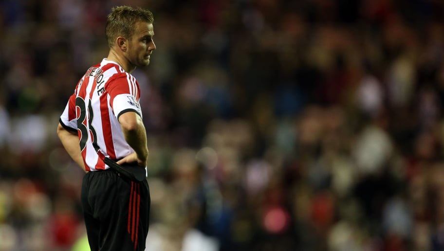Sunderland's Engkish midfielder Lee Cattermole looks dejected the end of the game during the English Premier League football match between Sunderland and Manchester United at The Stadium of Light in Sunderland, northeast England on October 5, 2013.  Manchester United won 2-1.  AFP PHOTO / IAN MACNICOL  RESTRICTED TO EDITORIAL USE. No use with unauthorized audio, video, data, fixture lists, club/league logos or live services. Online in-match use limited to 45 images, no video emulation. No use in betting, games or single club/league/player publications.        (Photo credit should read Ian MacNicol,Ian MacNicol/AFP/Getty Images)