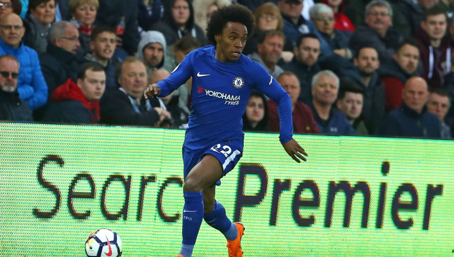 Chelsea's Brazilian midfielder Willian runs with the ball during the English Premier League football match between Swansea City and Chelsea at The Liberty Stadium in Swansea, south Wales on April 28, 2018. - Chelsea won the game 1-0. (Photo by Geoff CADDICK / AFP) / RESTRICTED TO EDITORIAL USE. No use with unauthorized audio, video, data, fixture lists, club/league logos or 'live' services. Online in-match use limited to 75 images, no video emulation. No use in betting, games or single club/league/player publications. /         (Photo credit should read GEOFF CADDICK/AFP/Getty Images)