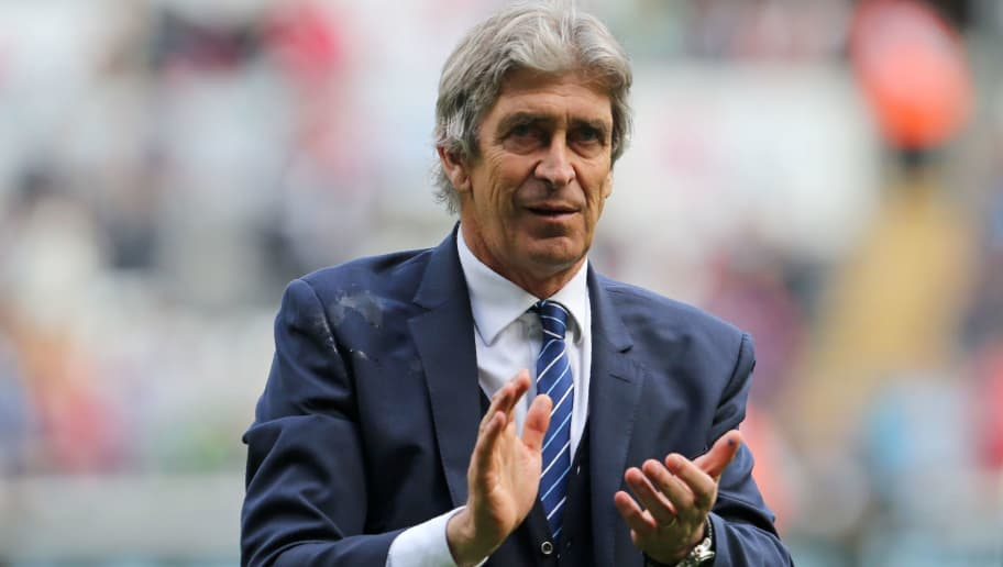Manchester City's Chilean manager Manuel Pellegrini applauds on the pitch after the English Premier League football match between Swansea City and Manchester City at The Liberty Stadium in Swansea, south Wales on May 15, 2016. The game finished 1-1. / AFP / GEOFF CADDICK / RESTRICTED TO EDITORIAL USE. No use with unauthorized audio, video, data, fixture lists, club/league logos or 'live' services. Online in-match use limited to 75 images, no video emulation. No use in betting, games or single club/league/player publications.  /         (Photo credit should read GEOFF CADDICK/AFP/Getty Images)