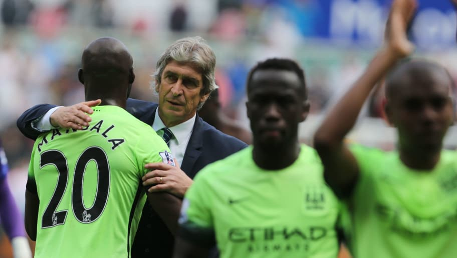 Manchester City's Chilean manager Manuel Pellegrini (2nd L) embraces Manchester City's French defender Eliaquim Mangala after the English Premier League football match between Swansea City and Manchester City at The Liberty Stadium in Swansea, south Wales on May 15, 2016. The game finished 1-1. / AFP / GEOFF CADDICK / RESTRICTED TO EDITORIAL USE. No use with unauthorized audio, video, data, fixture lists, club/league logos or 'live' services. Online in-match use limited to 75 images, no video emulation. No use in betting, games or single club/league/player publications.  /         (Photo credit should read GEOFF CADDICK/AFP/Getty Images)