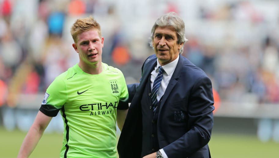 Manchester City's Chilean manager Manuel Pellegrini with Manchester City's Belgian midfielder Kevin De Bruyne (L) on the pitch after the English Premier League football match between Swansea City and Manchester City at The Liberty Stadium in Swansea, south Wales on May 15, 2016. The game finished 1-1. / AFP / GEOFF CADDICK / RESTRICTED TO EDITORIAL USE. No use with unauthorized audio, video, data, fixture lists, club/league logos or 'live' services. Online in-match use limited to 75 images, no video emulation. No use in betting, games or single club/league/player publications.  /         (Photo credit should read GEOFF CADDICK/AFP/Getty Images)