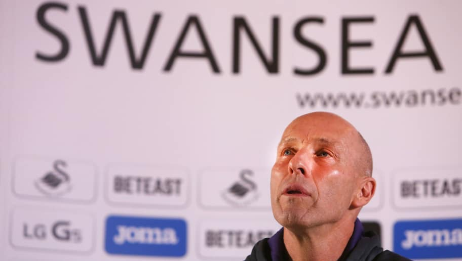 Premier League football club, Swansea City's new US manager Bob Bradley gestures as he hosts a press conference at the Marriot Hotel in Swansea, south wales on October 7, 2016. Swansea City hired former United States coach Bob Bradley as their new manager on Monday October 3, 2016 after the struggling Premier League club sacked Francesco Guidolin on his birthday. / AFP / Geoff CADDICK        (Photo credit should read GEOFF CADDICK/AFP/Getty Images)