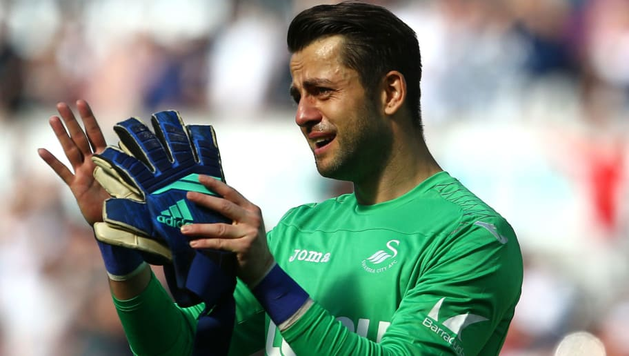Swansea City's Polish goalkeeper Lukasz Fabianski reacts after losing the English Premier League football match between Swansea City and Stoke City at The Liberty Stadium in Swansea, south Wales on May 13, 2018. (Photo by GEOFF CADDICK / AFP) / RESTRICTED TO EDITORIAL USE. No use with unauthorized audio, video, data, fixture lists, club/league logos or 'live' services. Online in-match use limited to 75 images, no video emulation. No use in betting, games or single club/league/player publications. /         (Photo credit should read GEOFF CADDICK/AFP/Getty Images)