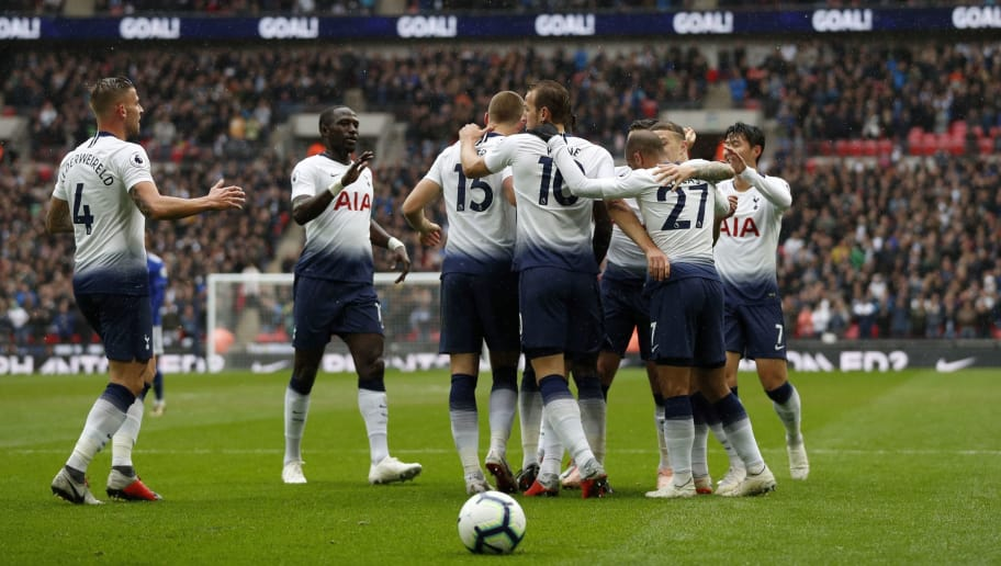 Tottenham Hotspur's English defender Eric Dier celebrates with teammates after scoring the team's first goal during the English Premier League football match between Tottenham Hotspur and Cardiff at Wembley Stadium in London, on October 6, 2018. (Photo by Adrian DENNIS / AFP) / RESTRICTED TO EDITORIAL USE. No use with unauthorized audio, video, data, fixture lists, club/league logos or 'live' services. Online in-match use limited to 120 images. An additional 40 images may be used in extra time. No video emulation. Social media in-match use limited to 120 images. An additional 40 images may be used in extra time. No use in betting publications, games or single club/league/player publications. /         (Photo credit should read ADRIAN DENNIS/AFP/Getty Images)