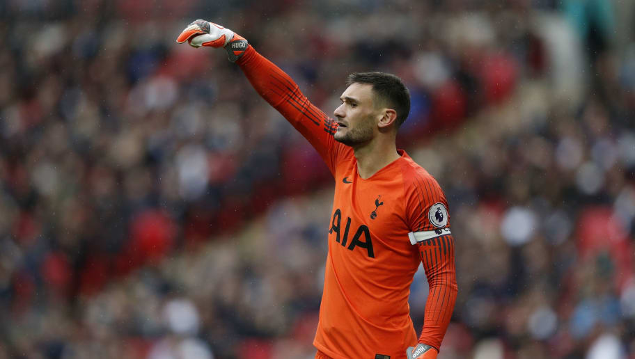 Tottenham Hotspur's French goalkeeper Hugo Lloris gestures during the English Premier League football match between Tottenham Hotspur and Cardiff at Wembley Stadium in London, on October 6, 2018. (Photo by Adrian DENNIS / AFP) / RESTRICTED TO EDITORIAL USE. No use with unauthorized audio, video, data, fixture lists, club/league logos or 'live' services. Online in-match use limited to 120 images. An additional 40 images may be used in extra time. No video emulation. Social media in-match use limited to 120 images. An additional 40 images may be used in extra time. No use in betting publications, games or single club/league/player publications. /         (Photo credit should read ADRIAN DENNIS/AFP/Getty Images)