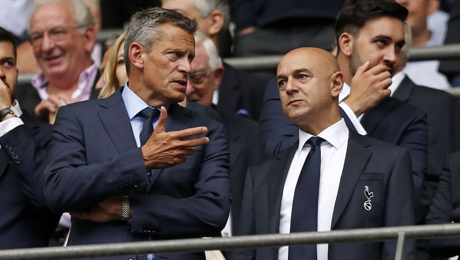 FA chief executive officer Martin Glenn (L) speaks with Tottenham Hotspur's English chairman Daniel Levy ahead of the English Premier League football match between Tottenham Hotspur and Fulham at Wembley Stadium in London, on August 18, 2018. (Photo by Ian KINGTON / AFP) / RESTRICTED TO EDITORIAL USE. No use with unauthorized audio, video, data, fixture lists, club/league logos or 'live' services. Online in-match use limited to 120 images. An additional 40 images may be used in extra time. No video emulation. Social media in-match use limited to 120 images. An additional 40 images may be used in extra time. No use in betting publications, games or single club/league/player publications. /         (Photo credit should read IAN KINGTON/AFP/Getty Images)