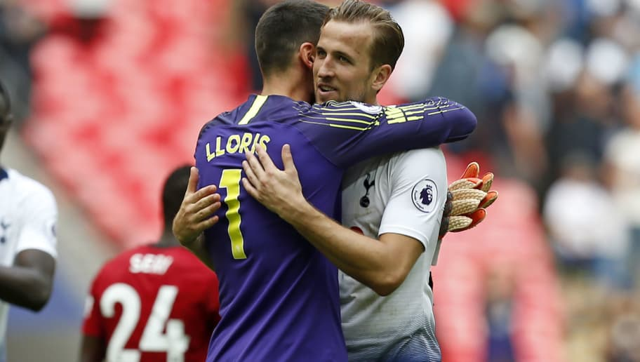 Tottenham Hotspur's English striker Harry Kane (R) embraces Tottenham Hotspur's French goalkeeper Hugo Lloris on the pitch after the English Premier League football match between Tottenham Hotspur and Fulham at Wembley Stadium in London, on August 18, 2018. - Tottenham won the game 3-1. (Photo by Ian KINGTON / AFP) / RESTRICTED TO EDITORIAL USE. No use with unauthorized audio, video, data, fixture lists, club/league logos or 'live' services. Online in-match use limited to 120 images. An additional 40 images may be used in extra time. No video emulation. Social media in-match use limited to 120 images. An additional 40 images may be used in extra time. No use in betting publications, games or single club/league/player publications. /         (Photo credit should read IAN KINGTON/AFP/Getty Images)