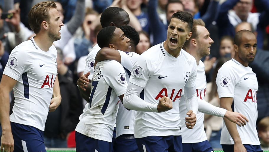 Tottenham Hotspur's Argentinian midfielder Erik Lamela (C) celebrates with teammates after scoring their fourth goal during the English Premier League football match between Tottenham Hotspur and Leicester City at Wembley Stadium in London, on May 13, 2018. - Tottenham won the game 5-4. (Photo by Ian KINGTON / AFP) / RESTRICTED TO EDITORIAL USE. No use with unauthorized audio, video, data, fixture lists, club/league logos or 'live' services. Online in-match use limited to 75 images, no video emulation. No use in betting, games or single club/league/player publications. /         (Photo credit should read IAN KINGTON/AFP/Getty Images)